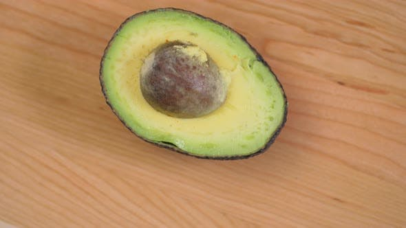 Thumbnail for Half An Avocado With Nut Spinnin On Cutting Board 01