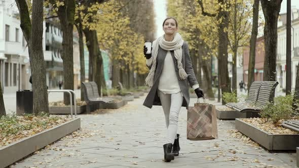 Thumbnail for Happy Woman Walking With Shopping Bags And Coffee