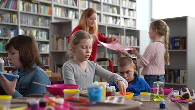 Kids with Special Needs Playing Slimes in Library