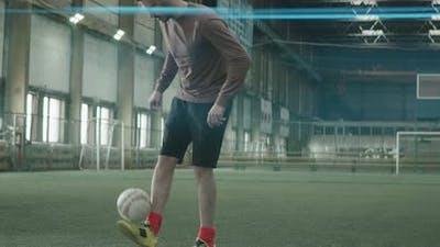Sportsman Juggling Soccer Ball on Indoor Field