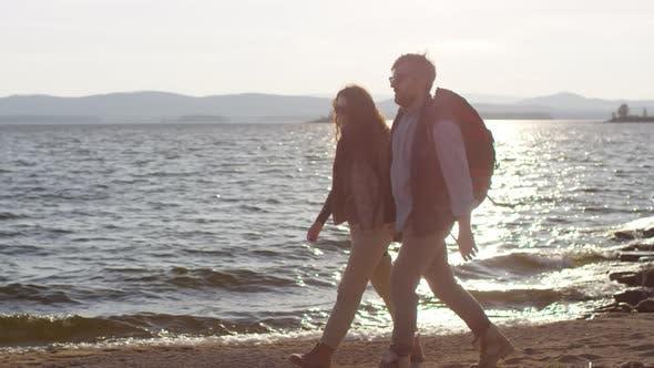 Thumbnail for Tourist Couple Having Romantic Walk on Rocky Lakeshore