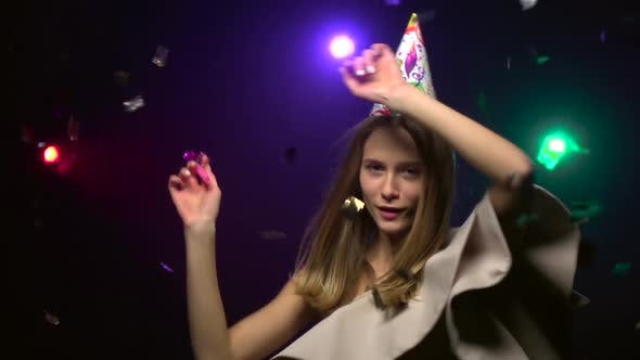 Thumbnail for Close-up of Dancing Girl in Party Hats. Slow Motion