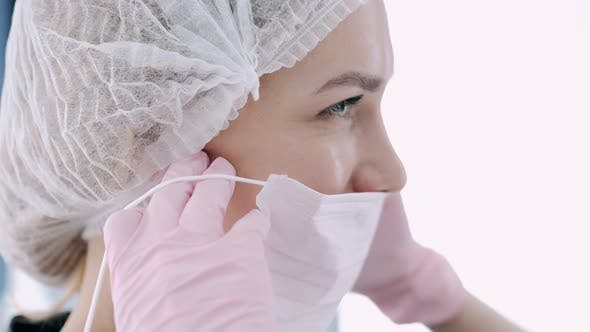Thumbnail for Cropped View of Doctor Putting on Mask Before Procedure