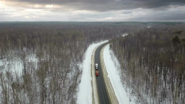 Thumbnail for Trucks On Winter Road At Stormy Weather