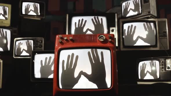 Thumbnail for Stacks of Retro TVs with Many Hands on the Screens.