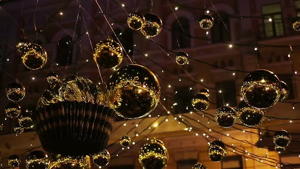Thumbnail for Shiny Golden Decorations Hanging Outdoors, Sparkling to Create Festive Mood
