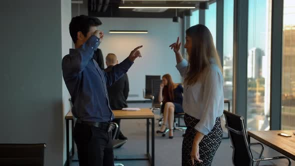 Thumbnail for Happy Business Team Celebrating with Dance in Their Office