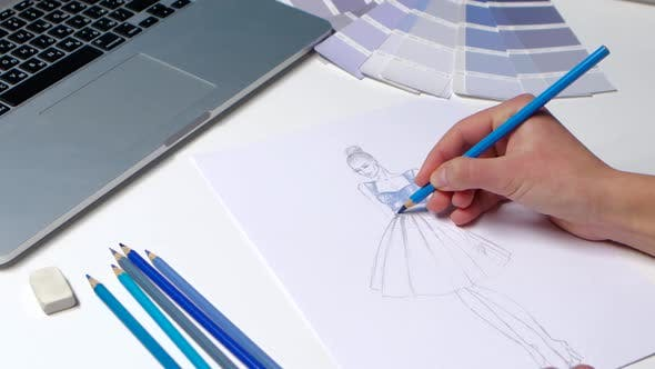 Thumbnail for Designer with a Pencil Sketch Decorates Dresses in Blue. Close Up