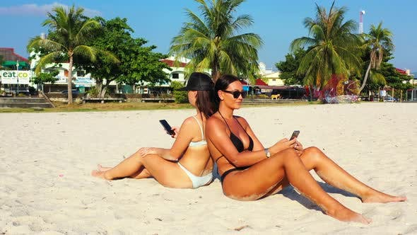 Thumbnail for Sexy happy ladies travelling enjoying life on the beach on summer white sand and blue background 4K