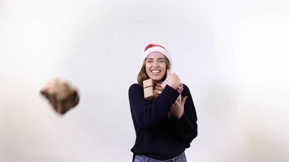 Thumbnail for Girl receiving Christmas gifts