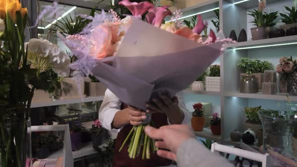 Thumbnail for Happy Florist Giving Bouquet To Customer