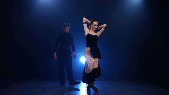 Thumbnail for Latinamerican Dancing Pair of Professional Elegant Dancers in Smoky Studio
