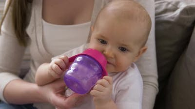 Close Up of Mother with Baby Drinking Water