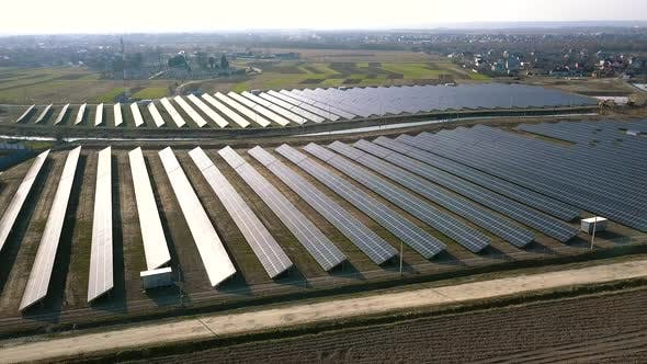 Thumbnail for Aerial Drone View Landscape of a Solar Plant That Is Located Inside a Valley, Produces Green