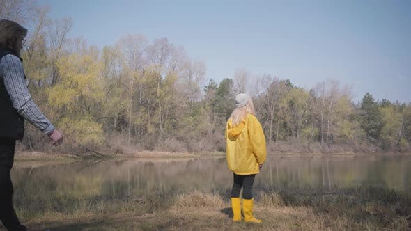 Thumbnail for Young Blond Woman Standing Looking at Amazing View of River and Forest and Bearded Handsome Man Come