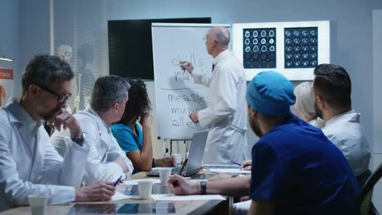 Thumbnail for Doctor Explaining Diagnosis To His Colleagues