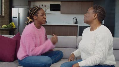 Caring Black Mom Consoling Upset Daughter with Teenage Problems