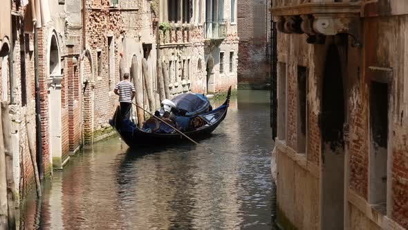 Thumbnail for Gondola in a canal in Venice