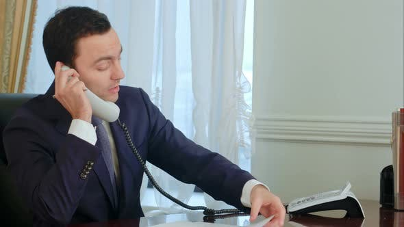 Thumbnail for Young Businessman Become Worried and Angry After Having a Phone Call and Puts the Phone Down