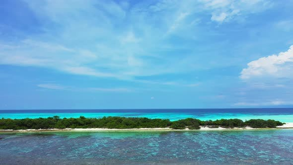 Thumbnail for Wide angle above clean view of a summer white paradise sand beach and aqua turquoise water backgroun