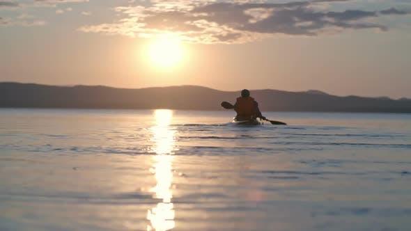 Paddling Kayak at Sunset
