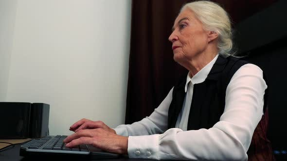 Thumbnail for Old Caucasian Woman Works on Computer in Home