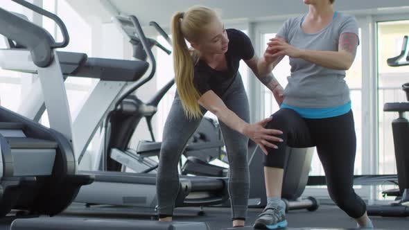 Thumbnail for Woman Doing Lunges under Control of Trainer