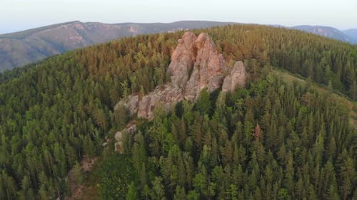 Aerial View of Rocks and Forest Nature Reserve Pillars at Sunset