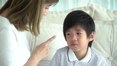 Asian Child Crying While Mother Scolding