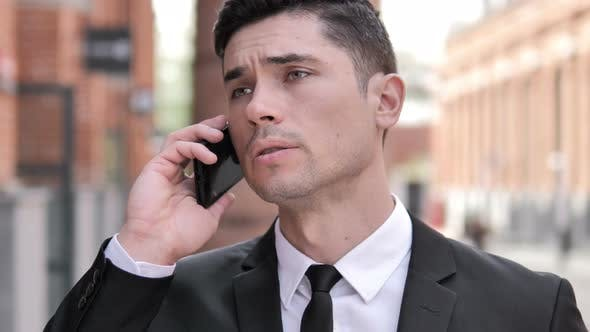 Thumbnail for Businessman Talking on Phone, Outdoor