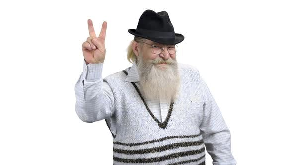 Cheerful Senior Man Demonstrating Victory Sign