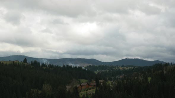 Carpathian Mountains with peaks, time lapse. Cloudy sky.
