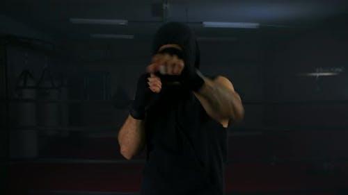 Man Boxer In Hoodie