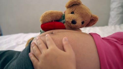 Happy Pregnant Woman Sleeping on Bed in Bedroom