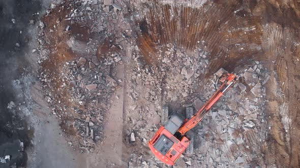 View From Above. A Large Excavator Dismantles the Concrete Base