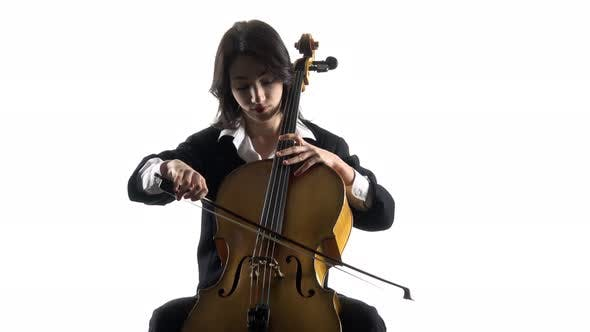 Thumbnail for Musician Girl Plays a Violoncello Rehearsing a Composition. White Background