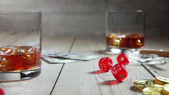 Thumbnail for Whiskey in Highballs on a Wooden Table and Dice