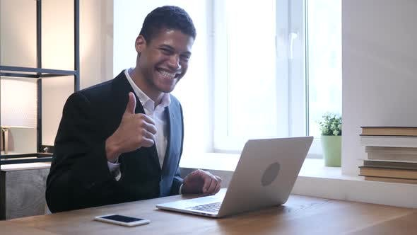 Thumbnail for Thumbs Up by Black Man working on Laptop