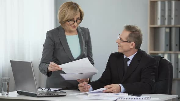 Thumbnail for Glad professional partners man and woman working on investment plans, statistics