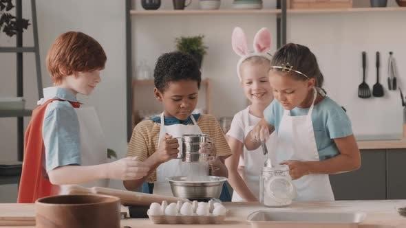 Diverse Children Playing in Kitchen