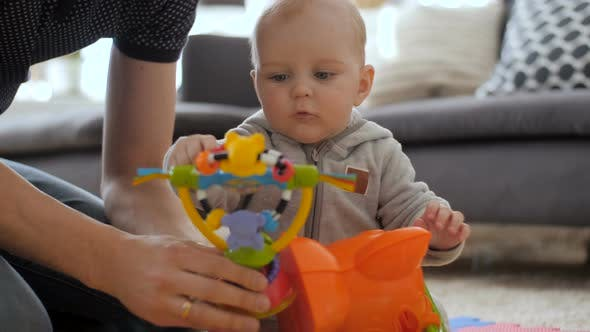 Thumbnail for Baby Boy Playing With Colourful Toy