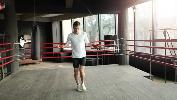 Thumbnail for Boxer Man Training with a Jumping Rope