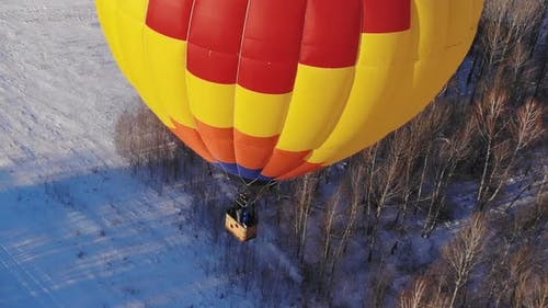Big Bright Balloon Over the Winter Forest