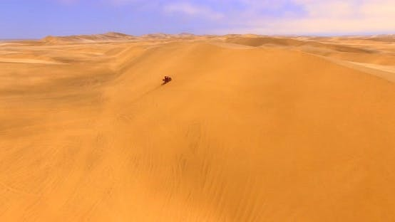 Thumbnail for Tourist Wearing Red Tracksuit Rides ATV Within an Ocean of Enormous Red Dunes
