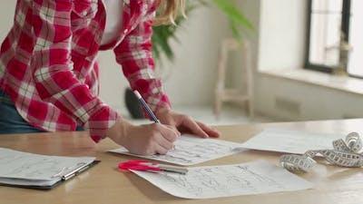 Closeup Woman Fashion Designer Hand Working in Office Workshop