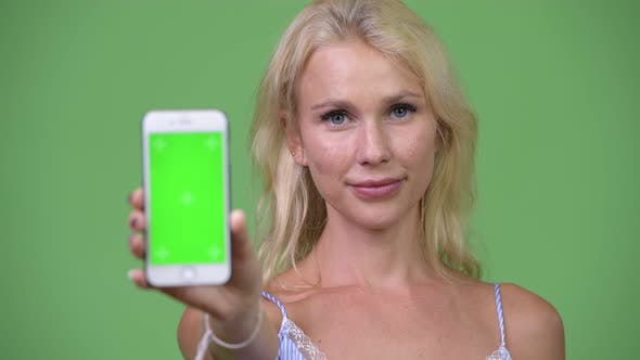 Thumbnail for Young Happy Beautiful Businesswoman Showing Phone