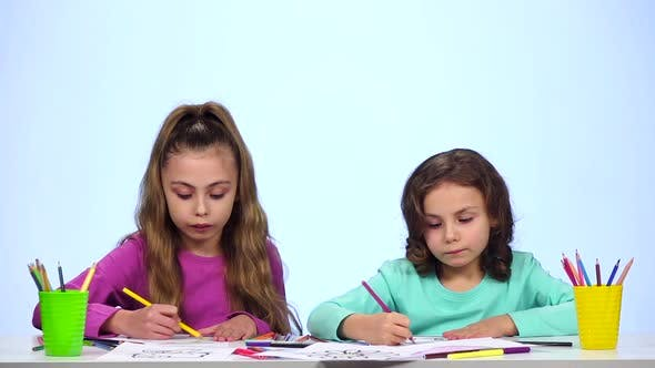 Thumbnail for Children Sisters, Decorate the Picture with Pencils. White Background. Slow Motion