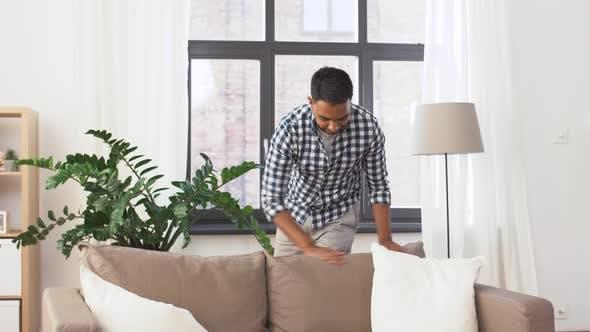 Thumbnail for Indian Man Arranging Sofa Cushions at Home 46