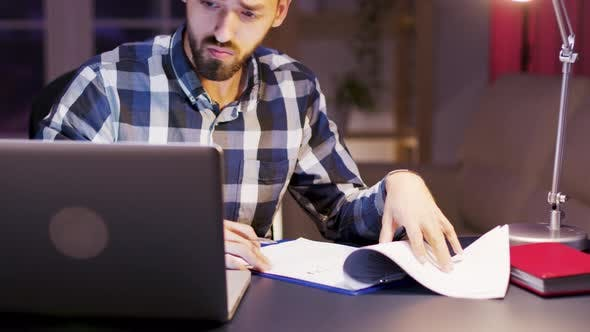 Thumbnail for Caucasian Businessman Working on Laptop in Home Office