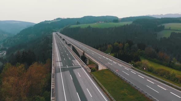 Thumbnail for Aerial View of the Highway Viaduct on Concrete Pillars in the Mountains